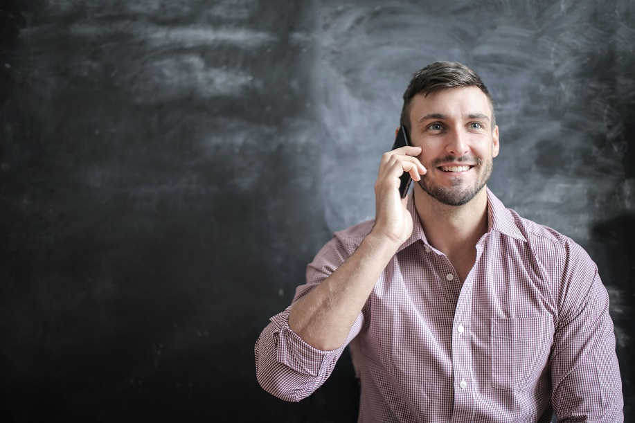 male talking on cell phone