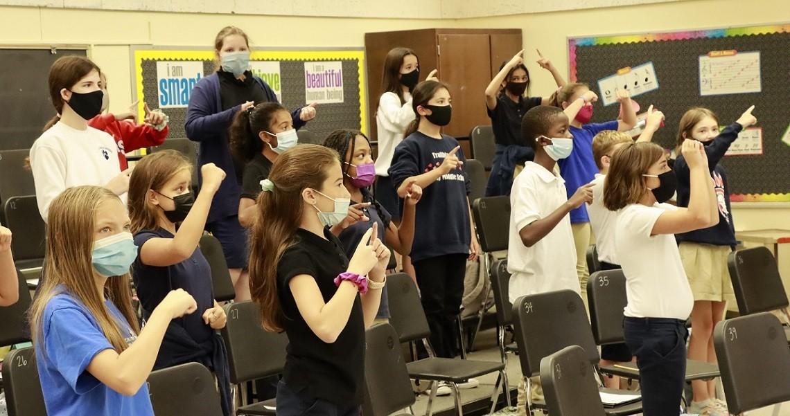 Crosby Middle School choir class making solfege hand signs