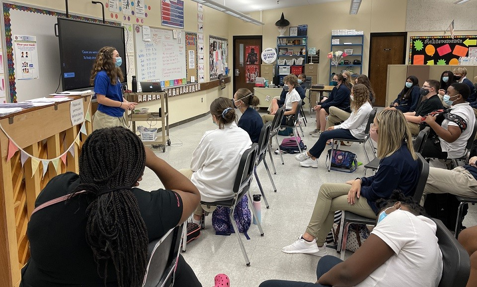 Crosby Middle School choir student speaking in front of class